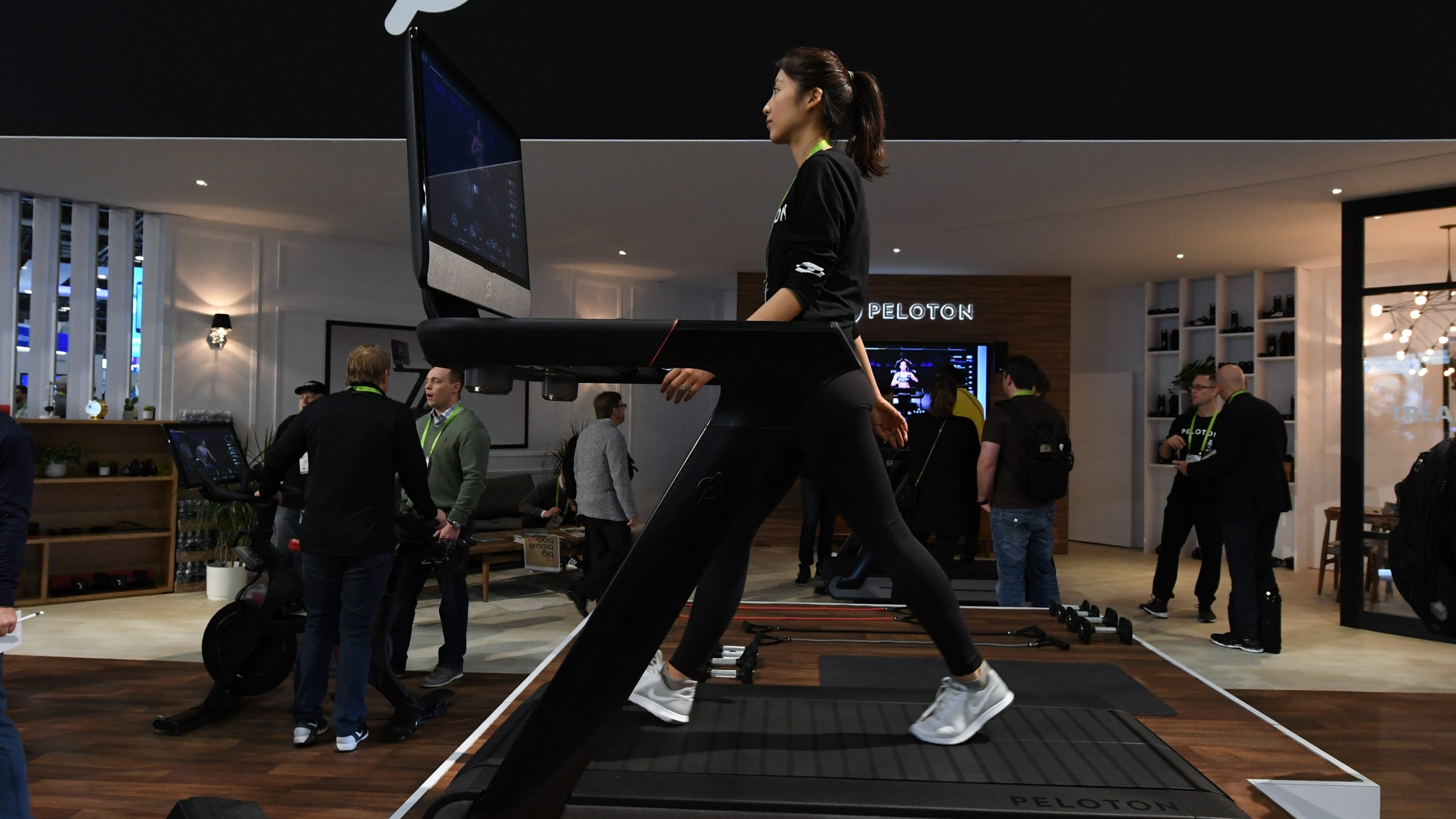 Maggie Lu uses a Peloton Tread treadmill during CES 2018 at the Las Vegas Convention Center on January 11, 2018 in Las Vegas, Nevada. (Ethan Miller/Getty Images)