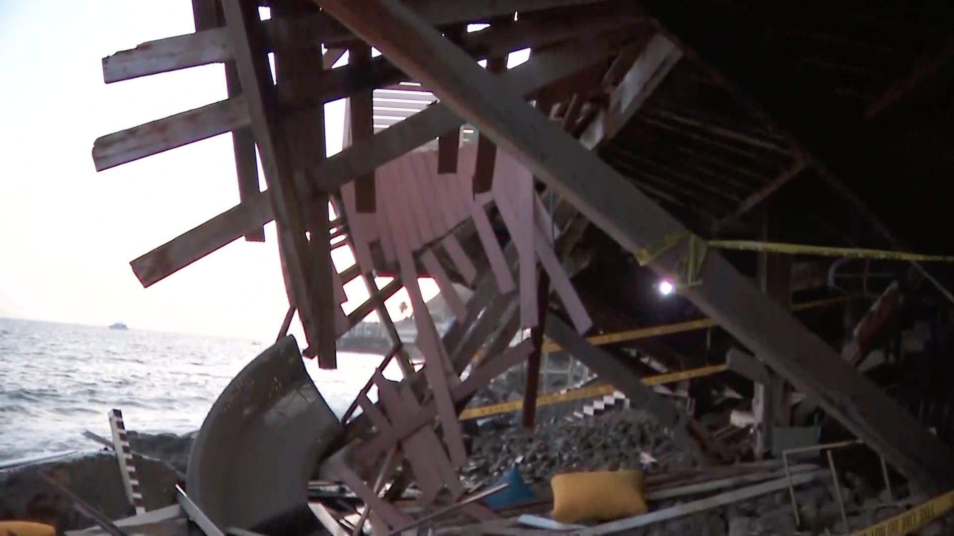 A balcony collapsed in a Malibu home, causing a group of people to fall over rocks Saturday evening.