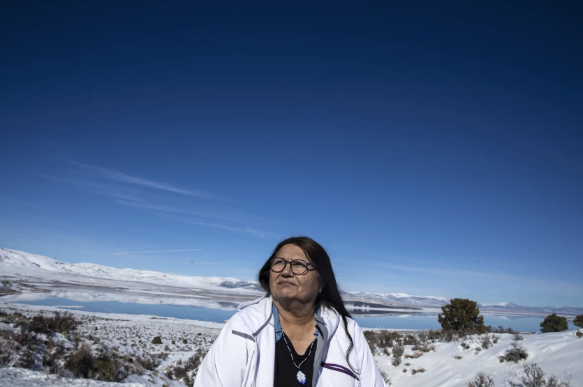 Charlotte Lange, 67, chairwoman of the Mono Lake Kutzadika Paiute tribe, sits for a portrait in February on a bluff in Lee Vining overlooking the lake. The tribe is among roughly two dozen unrecognized and landless tribes in California.(Brian van der Brug / Los Angeles Times)
