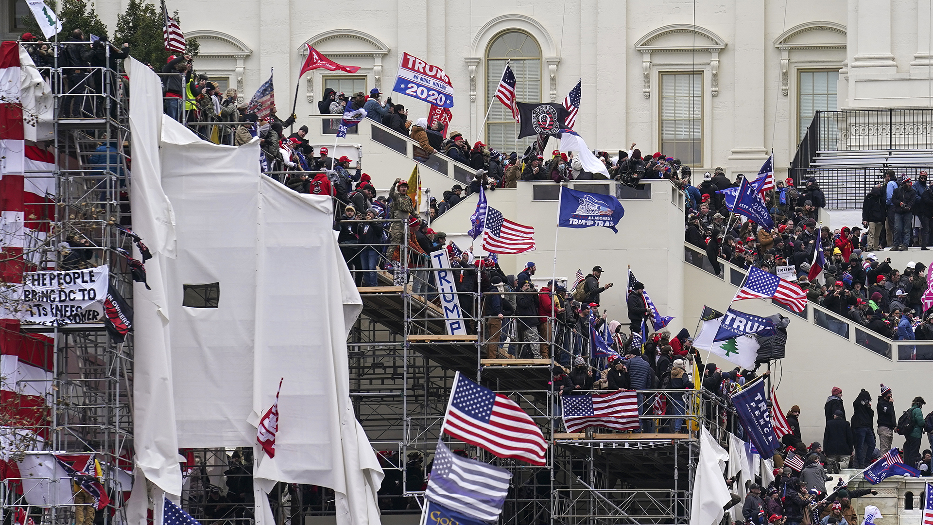 In this Jan. 6, 2021, file photo rioters loyal to President Donald Trump storm the U.S. Capitol in Washington.n(AP Photo/John Minchillo, File)