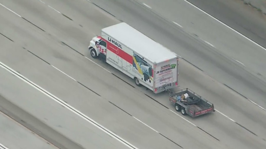 A stolen U-Haul truck being pursued by CHP officers is seen on the 605 Freeway near Cerritos on May 11, 2021. (KTLA)