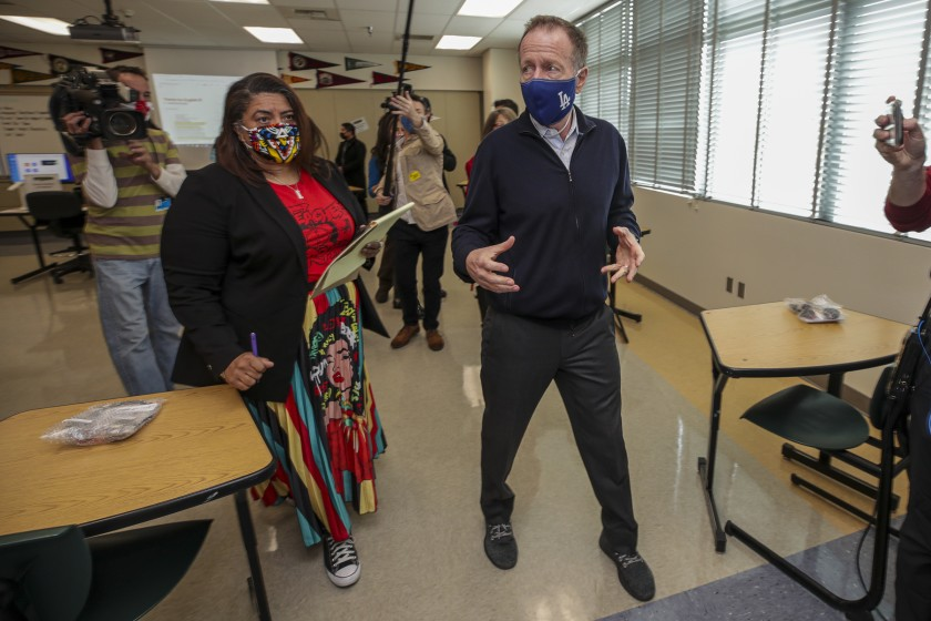 Teachers union President Cecily Myart-Cruz, left, and L.A. schools Supt. Austin Beutner inspect COVID-19 safety preparations at Panorama High School in March. Beutner had wanted a longer school year, but the union opposed it based on a survey of members.(Irfan Khan / Los Angeles Times)