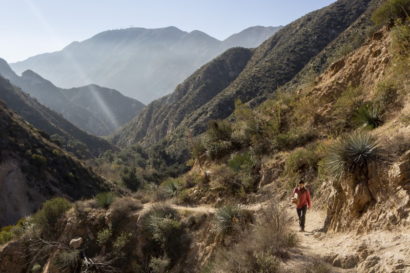 Bryan Matsumoto, a program organizer for Nature For All, walks along the Trail Canyon Falls trail in the Tujunga Canyon in the San Gabriel Mountains in this undated photo. (Gabriella Angotti-Jones / Los Angeles Times)