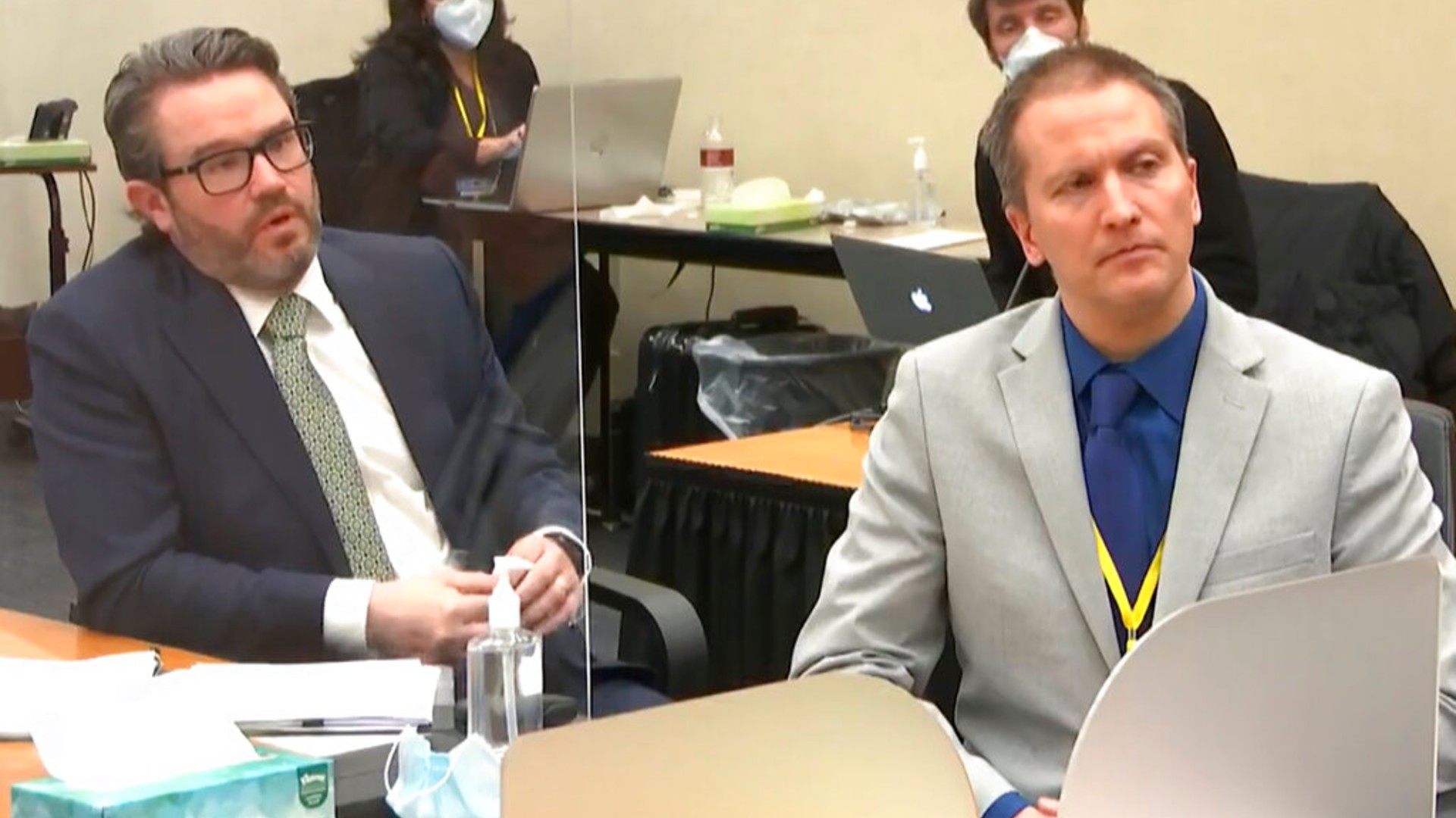 In this April 19, 2021, file image from video, defense attorney Eric Nelson, left, and defendant, former Minneapolis police officer Derek Chauvin, speak to Hennepin County Judge Peter Cahill. (Court TV via AP, Pool File)
