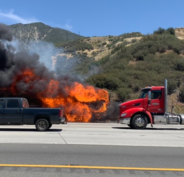 The Devore Fire burns along the Cajon Pass on Interstate 15 on May 4, 2021, in a photo released by Caltrans.