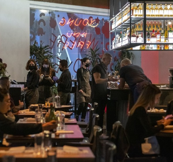 Diners eat inside E.P. restaurant in West Hollywood on May 8, 2021. (Francine Orr / Los Angeles Times)