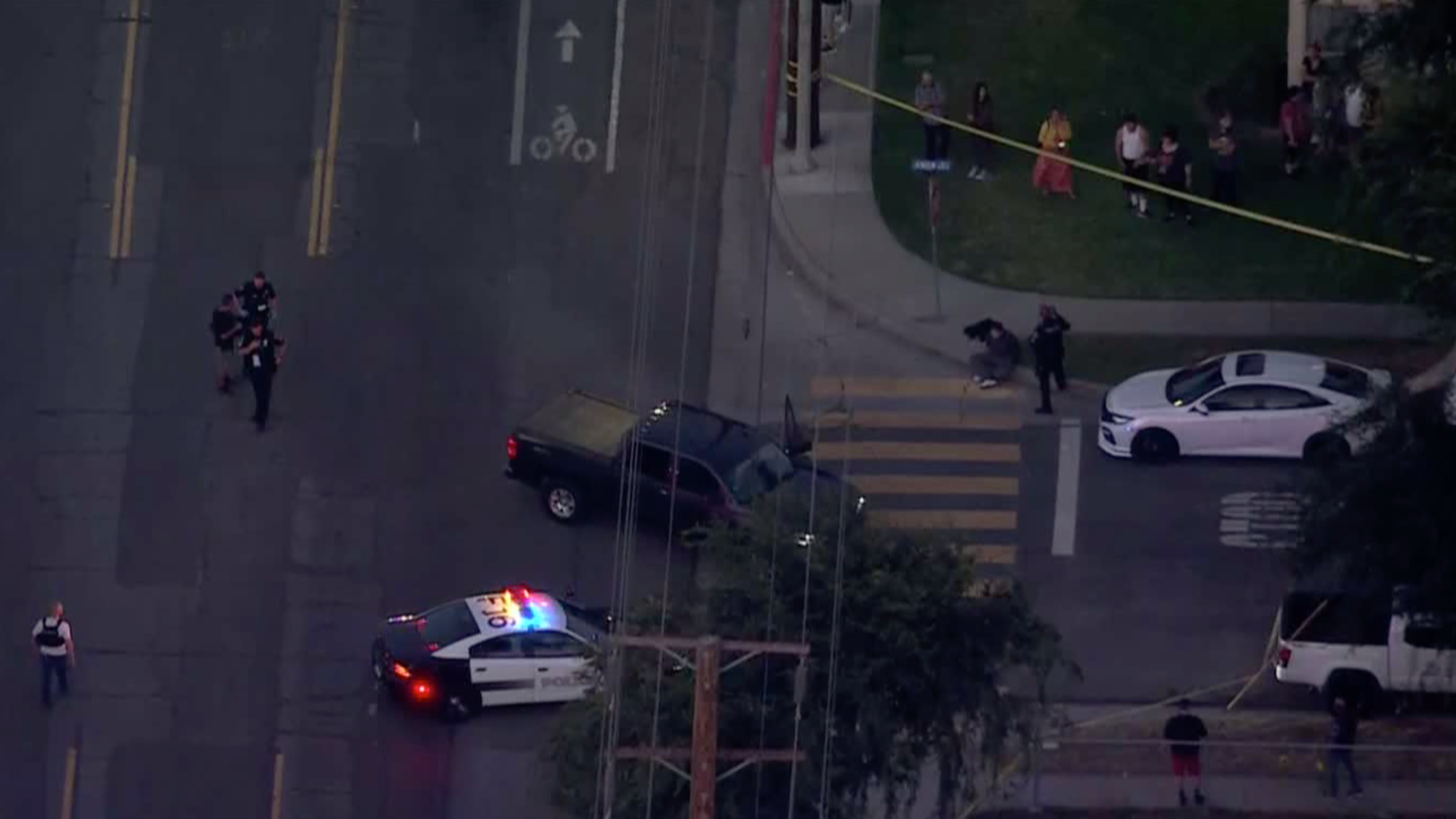 Authorities respond to investigate after a car crashed into a structure and a person was killed in a shooting in Fullerton on May 28, 2021. (KTLA)