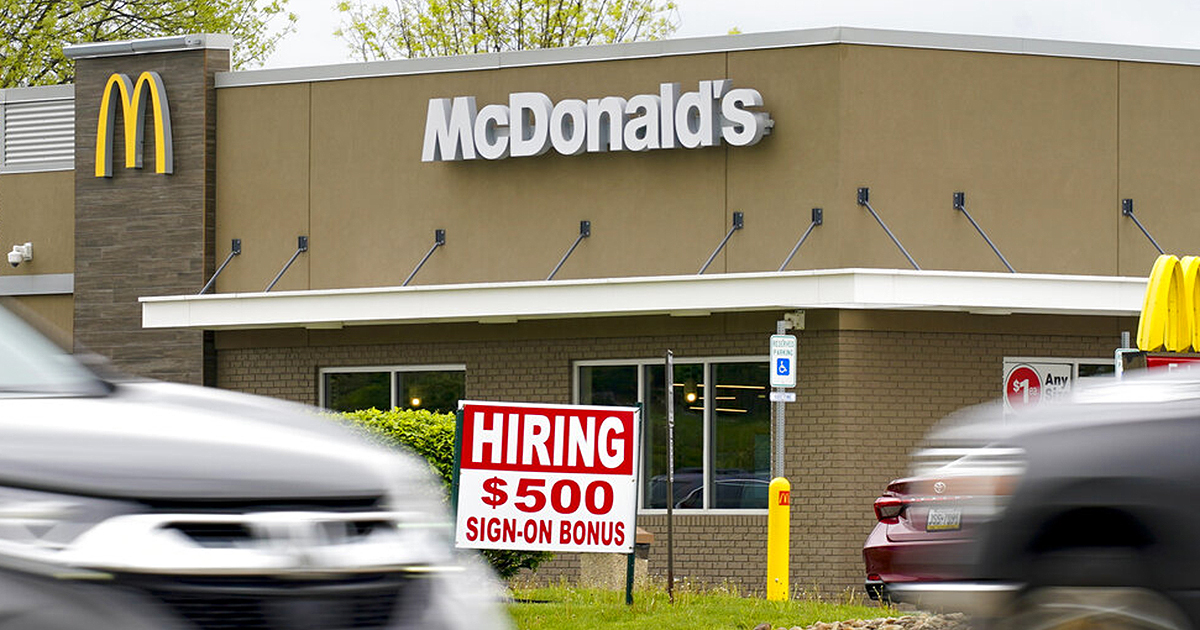 A hiring sign offers a $500 bonus outside a McDonalds restaurant, in Cranberry Township, Butler County, Pa., Wednesday, May 5, 2021. (AP Photo/Keith Srakocic)