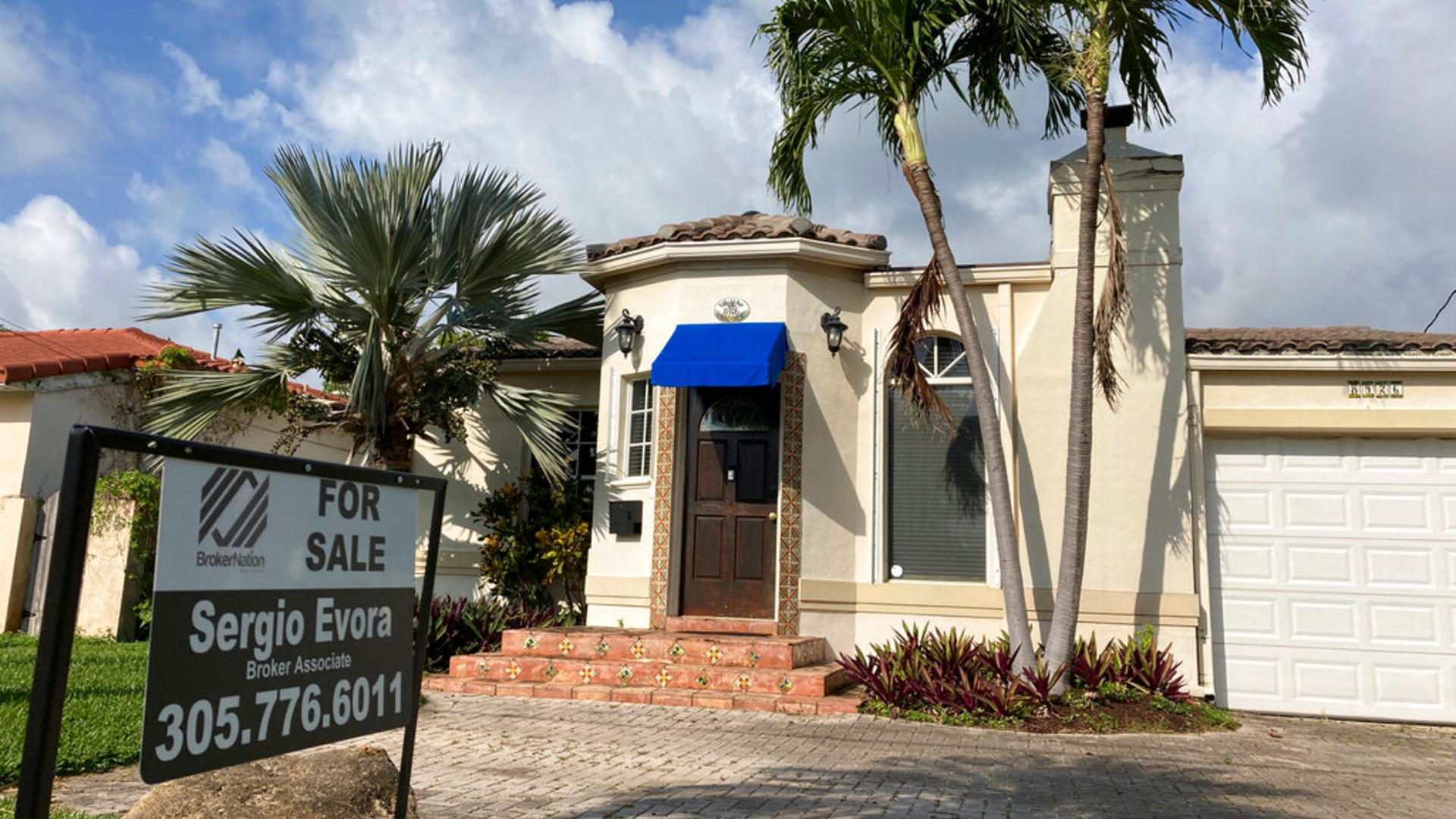 A home is shown for sale, Thursday, March 18, 2021, in Surfside, Fla. (AP Photo/Wilfredo Lee)