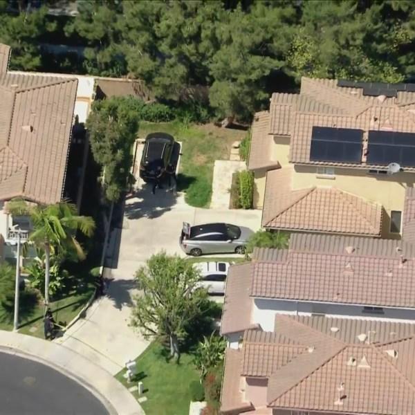 A woman was found dead in an Irvine neighborhood on May 4, 2021. (KTLA)