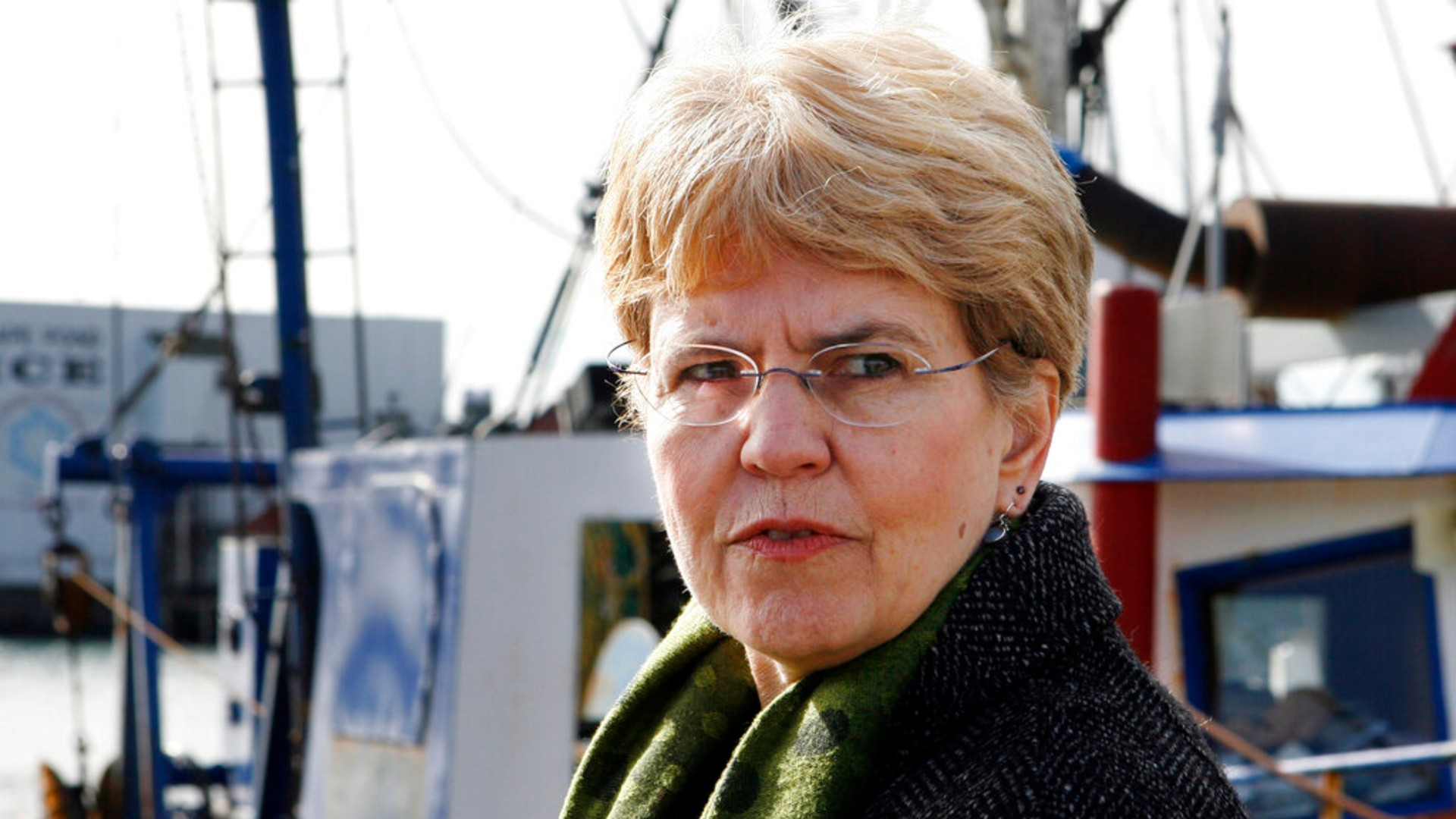 In this March 2, 2010, file photo, National Oceanic and Atmospheric Administration, NOAA, chief, Jane Lubchenco looks out from the waterfront as she speaks to fisherman in Gloucester, Mass. (AP Photo/Mary Schwalm, File)