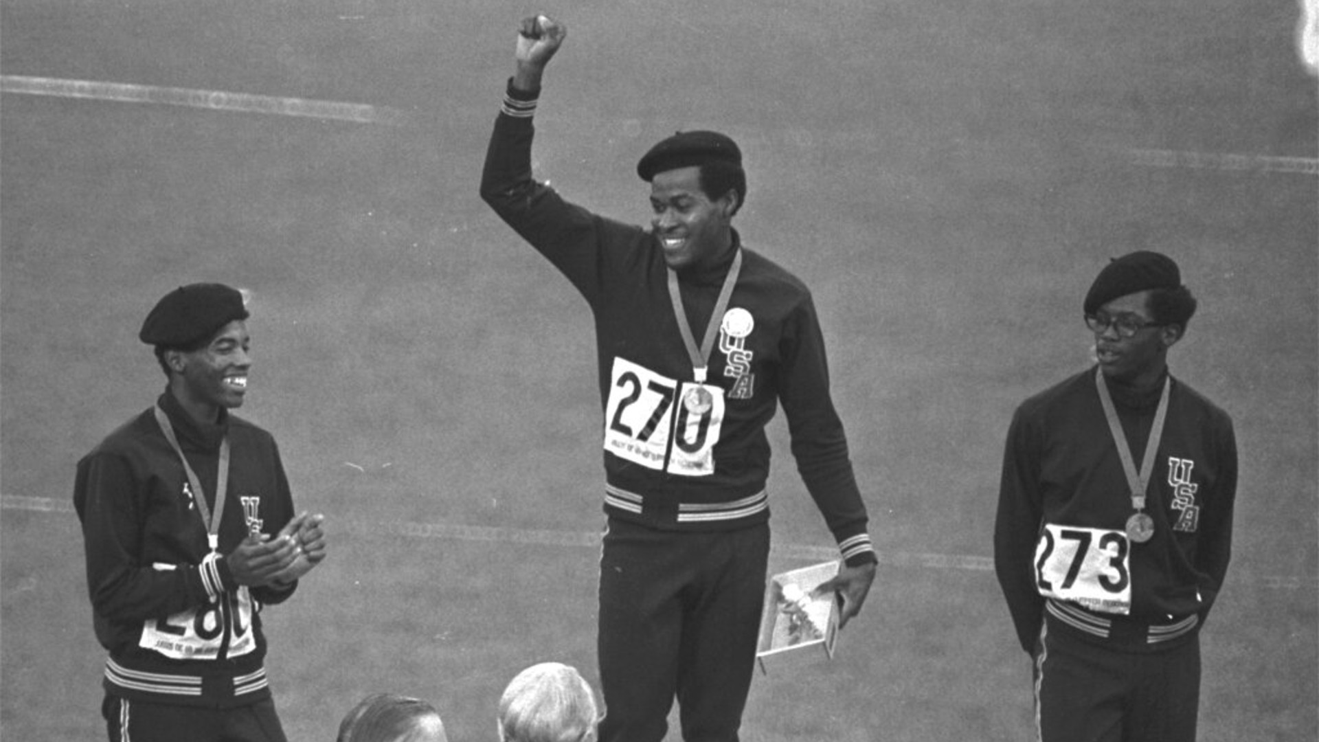 United States runners Larry James, left, Lee Evans, center, and Ron Freeman are shown after receiving their medals for the 400-meter race at the Mexico City Games in Mexico City, in this Oct. 18, 1968, file photo. (AP Photo/File)