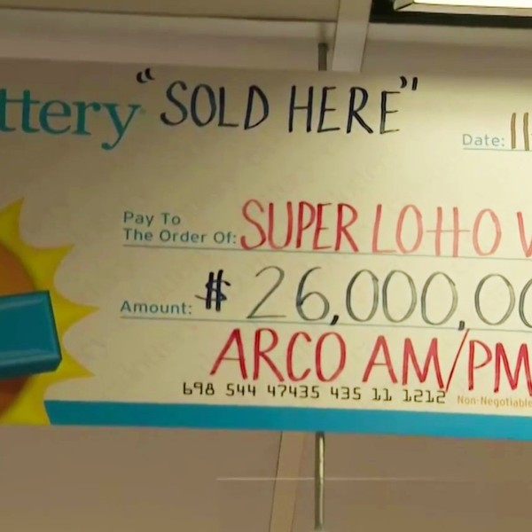 A sign advertising a winning SuperLotto Plus ticket sold in Norwalk is seen in this file image. (KTLA)