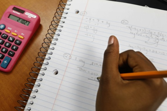 A student working on a math problem is seen in an undated photo. (Carolyn Cole / Los Angeles Times)