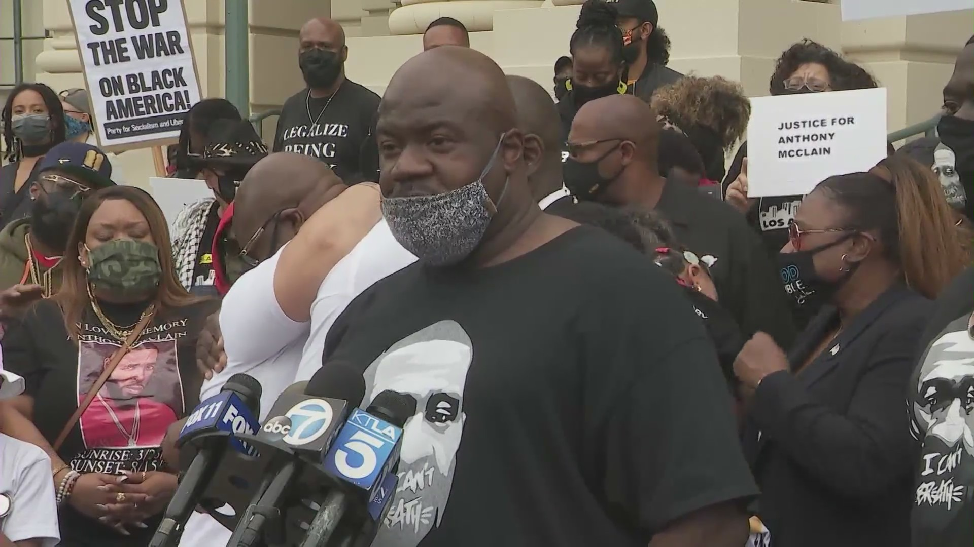 Activists outside Pasadena City Hall call for police accountability in the death of Anthony McClain on May 17, 2021. (KTLA)