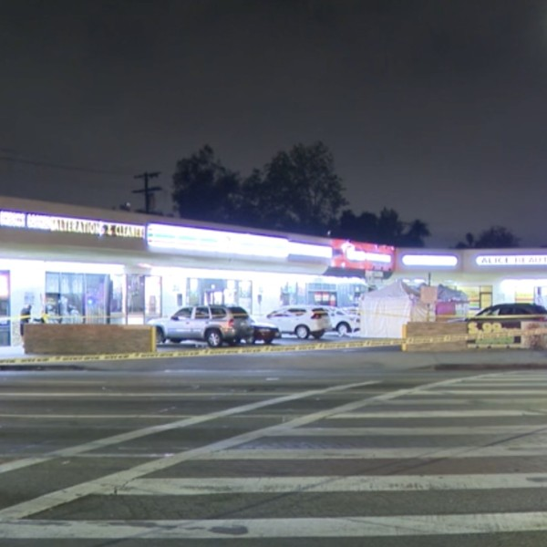 Los Angeles police investigate a fatal shooting in the MId-City neighborhood on May 3, 2021. (KTLA)