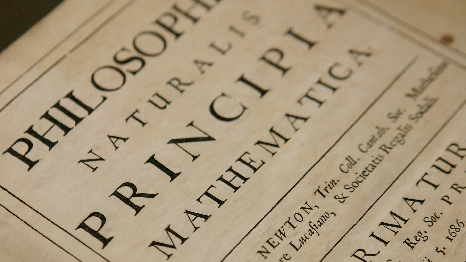 In this photo illustration, Head of Library and Archives Rupert Williams (unseen) holds a copy Philosphiae Naturalis Principia Mathematica (one of the most important scientific works ever written) by Sir Isaac Newton at the Science Museum Library and Archives on March 11, 2008 in Swindon, England. (Daniel Berehulak/Getty Images)