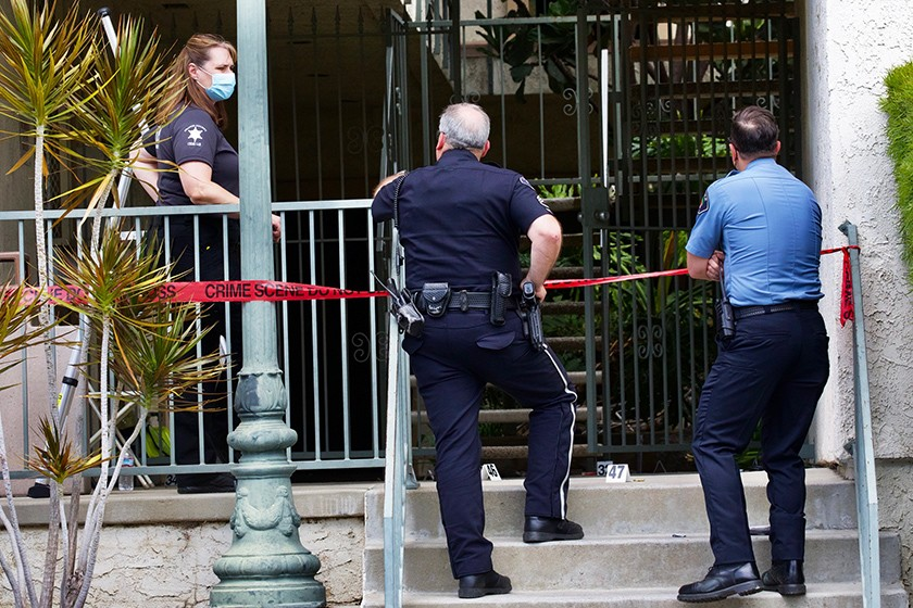 Police investigate a mass shooting in Orange that claimed the lives of four people, including a 9-year-old boy, on March 31, 2021. (Irfan Khan/Los Angeles Times)