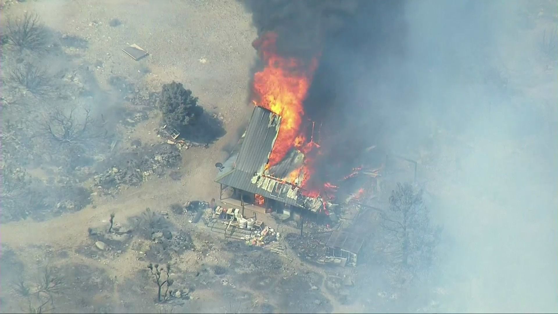 A structure burns in the Pine Fire outside Pinon Hills in the Antelope Valley on May 12, 2021. (KTLA)
