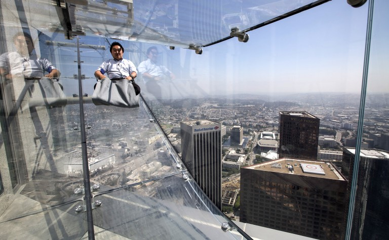A member of the media takes a four-second ride 1,000 feet above downtown Los Angeles on the 69th and 70th floors of U.S. Bank Tower during a preview in 2016. (Brian van der Brug / Los Angeles Times)