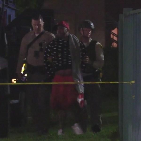 A man is taken into custody following an hourslong standoff in Palmdale. (DonLuisMeza)