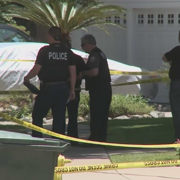 Police investigate at the scene where a woman was fatally stabbed in Upland on May 6, 2021. (KTLA)