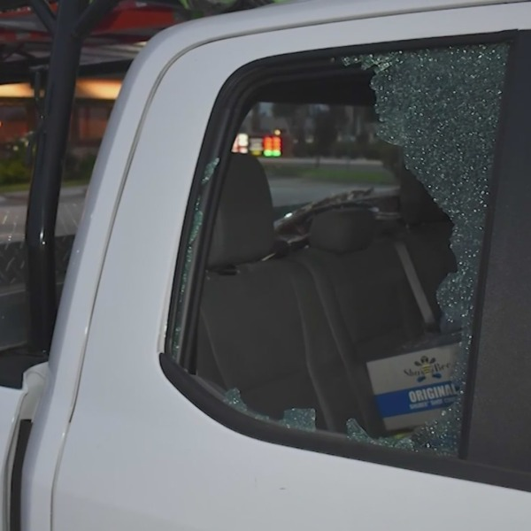 A car damaged by a BB or pellet gun shooting on the 91 Freeway in Riverside County is seen in a photo provided by the California Highway Patrol.