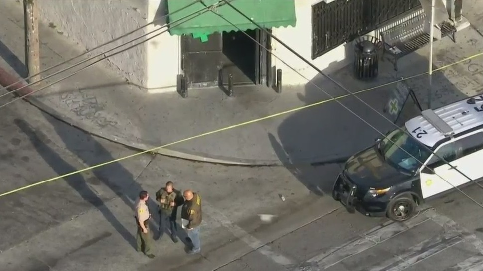 Authorities investigate at the scene where a 17-year-old boy was fatally shot in the Florence-Firestone neighborhood of unincorporated South Los Angeles on April 30, 2021. (KTLA)