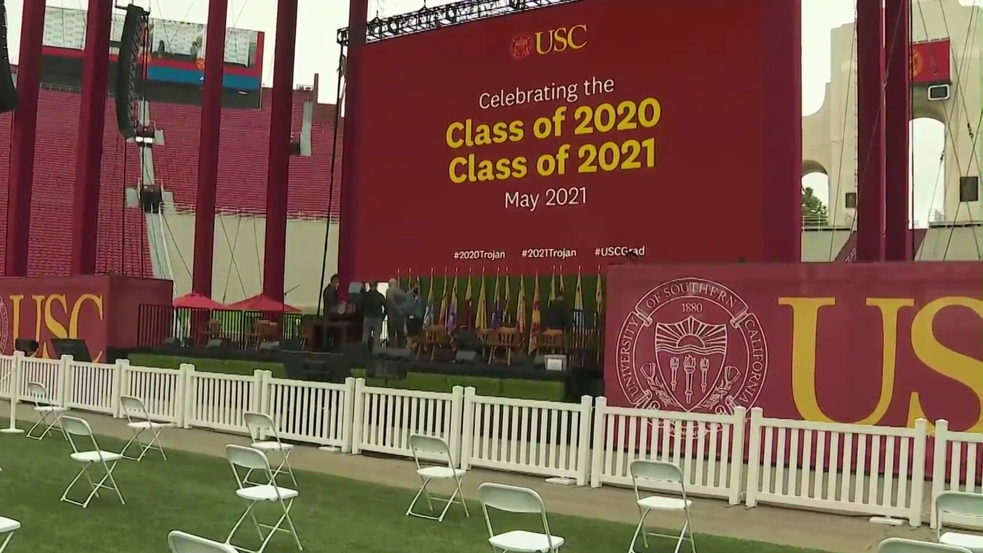 Preparations are made at the Los Angeles Memorial Coliseum for graduation ceremonies on May 14, 2021. (KTLA)