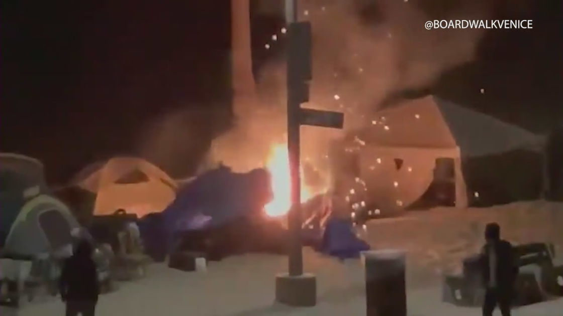 Video shared on the Twitter page @boardwalkvenice on May 5, 2021 shows a fire at a homeless camp along the boardwalk.