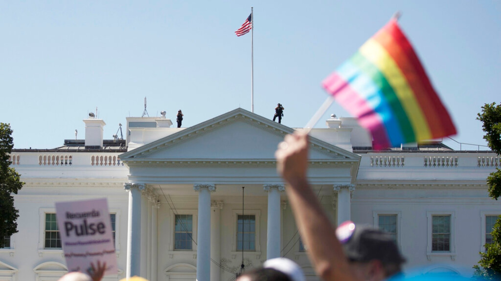 In this Sunday, June 11, 2017 file photo, Equality March for Unity and Pride participants march past the White House in Washington. (AP Photo/Carolyn Kaster)