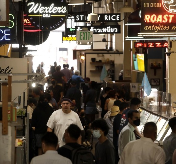 People wait for lunch at the Grand Central Market in downtown Los Angeles on June 15, 2021. (Genaro Molina / Los Angeles Times)