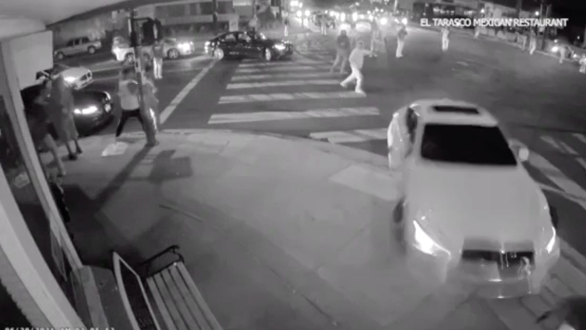 Security video from early Sunday morning caught the moment a Sylmar street takeover ended with a car up on the sidewalk and a girl jumping out of the way just before the car slammed into an empty restaurant. (El Tarasco Mexican Restaurant)