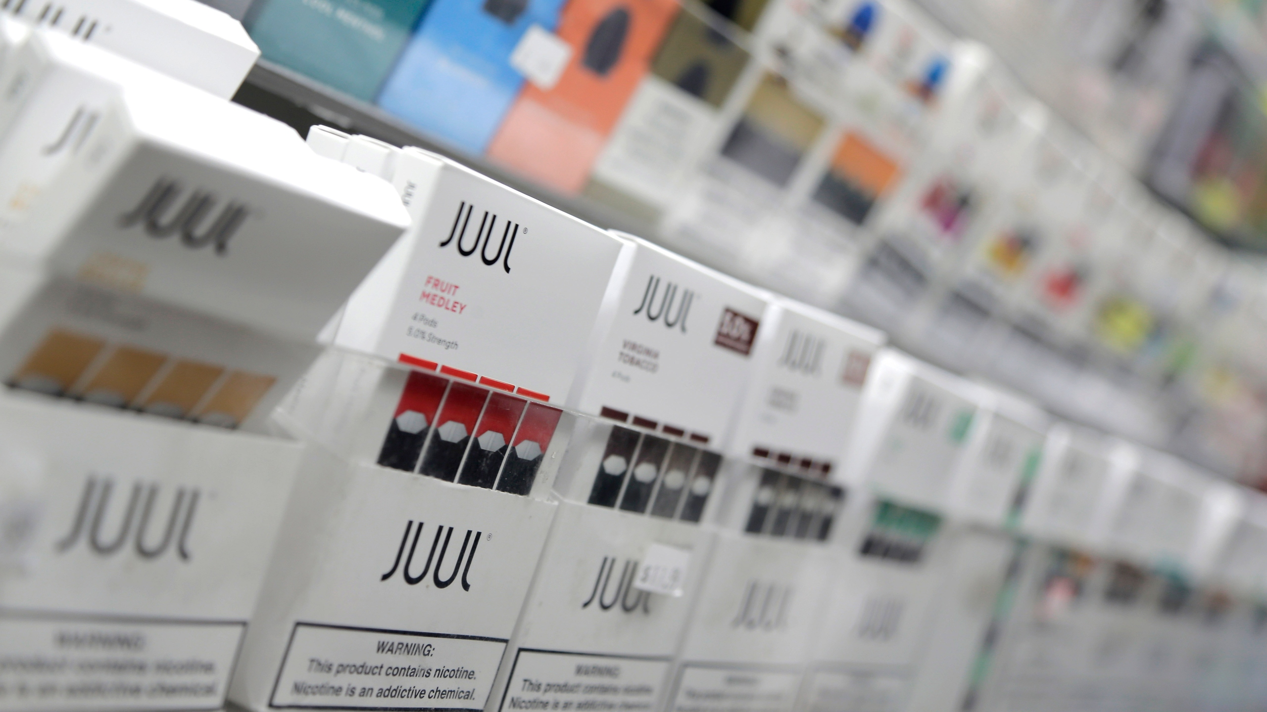In this Dec. 20, 2018, file photo, Juul products are displayed at a smoke shop in New York. (AP Photo/Seth Wenig, File)