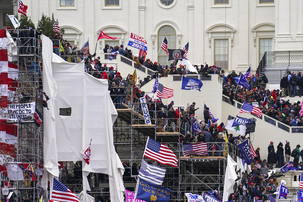 In this Jan. 6, 2021, file photo rioters loyal to President Donald Trump storm the U.S. Capitol in Washington. (Associated Press)