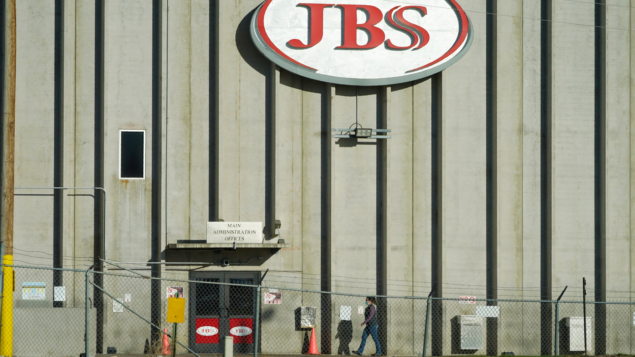 In this Oct. 12, 2020 file photo, a worker heads into the JBS meatpacking plant in Greeley, Colo. A weekend ransomware attack on the world's largest meat company is disrupting production around the world just weeks after a similar incident shut down a U.S. oil pipeline. The White House confirms that Brazil-based meat processor JBS SA notified the U.S. government Sunday, May 30, 2021, of a ransom demand from a criminal organization likely based in Russia. (AP Photo/David Zalubowski, File)