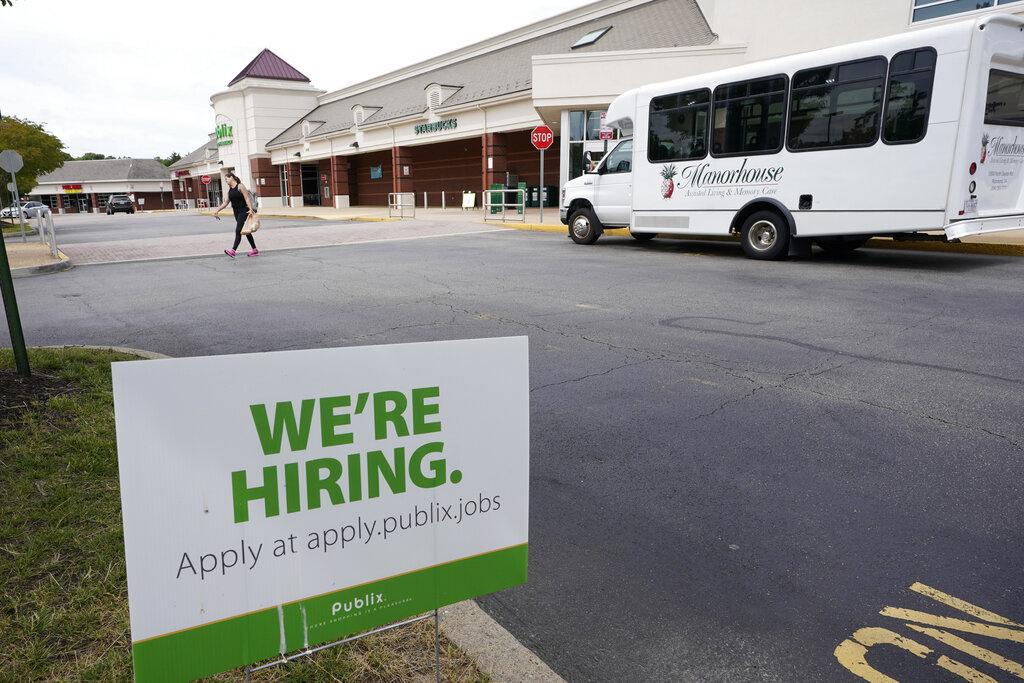 A We're Hiring sign at a Publix supermarket in Richmond, Va., Wednesday, June 2, 2021. (AP Photo/Steve Helber)