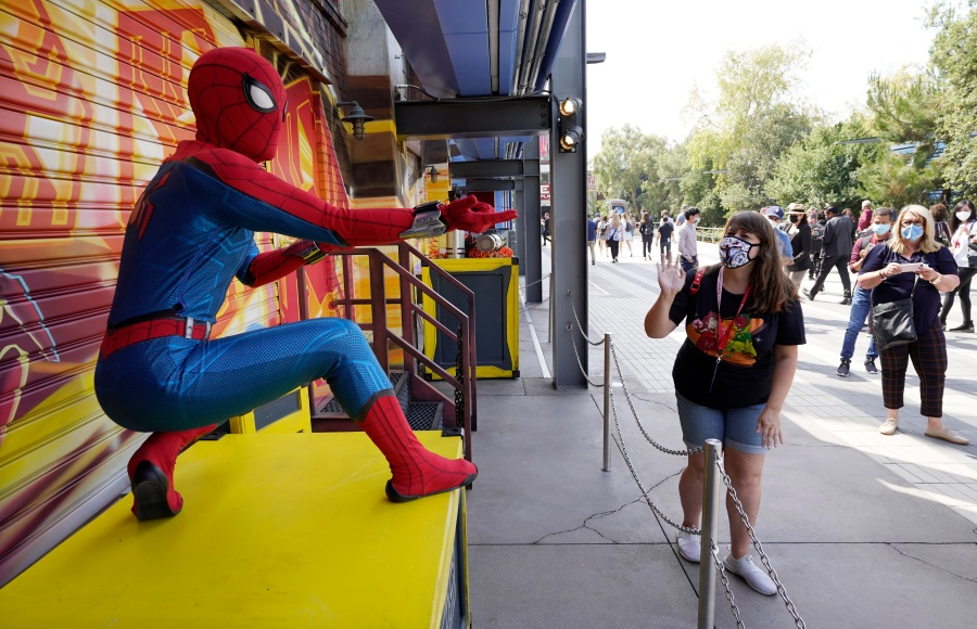 """A Spider-Man character poses for guests following """"The Amazing Spider-Man!"""" show at the Avengers Campus media preview at Disney's California Adventure Park on June 2, 2021, in Anaheim, Calif. (AP Photo/Chris Pizzello)"""