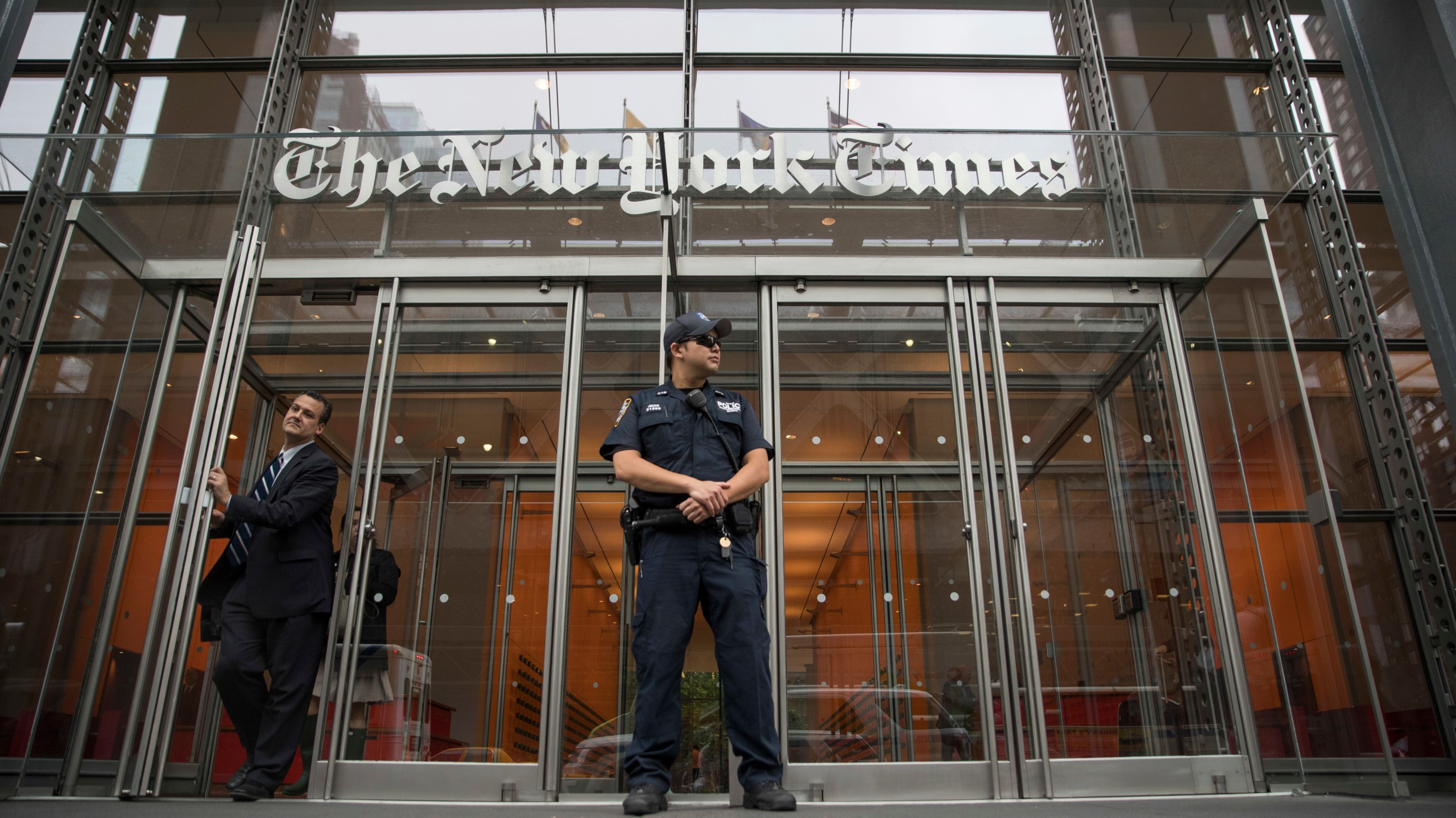 In this June 28, 2018, file photo, a police officer stands outside The New York Times building in New York. The Trump Justice Department secretly obtained the phone records of four New York Times journalists as part of a leak investigation, the newspaper said Wednesday, June 2, 2021. (AP Photo/Mary Altaffer, File)