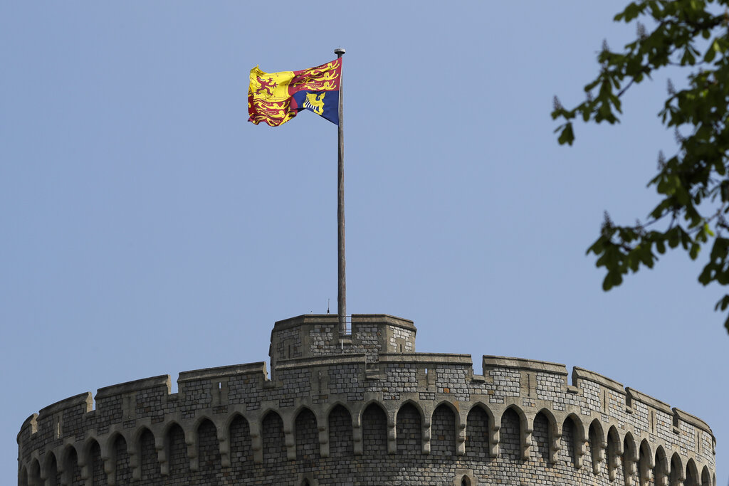 In this file photo dated Wednesday, April 21, 2021, The Royal Standard flies above Windsor Castle in Windsor, England. (AP Photo/Kirsty Wigglesworth, FILE)