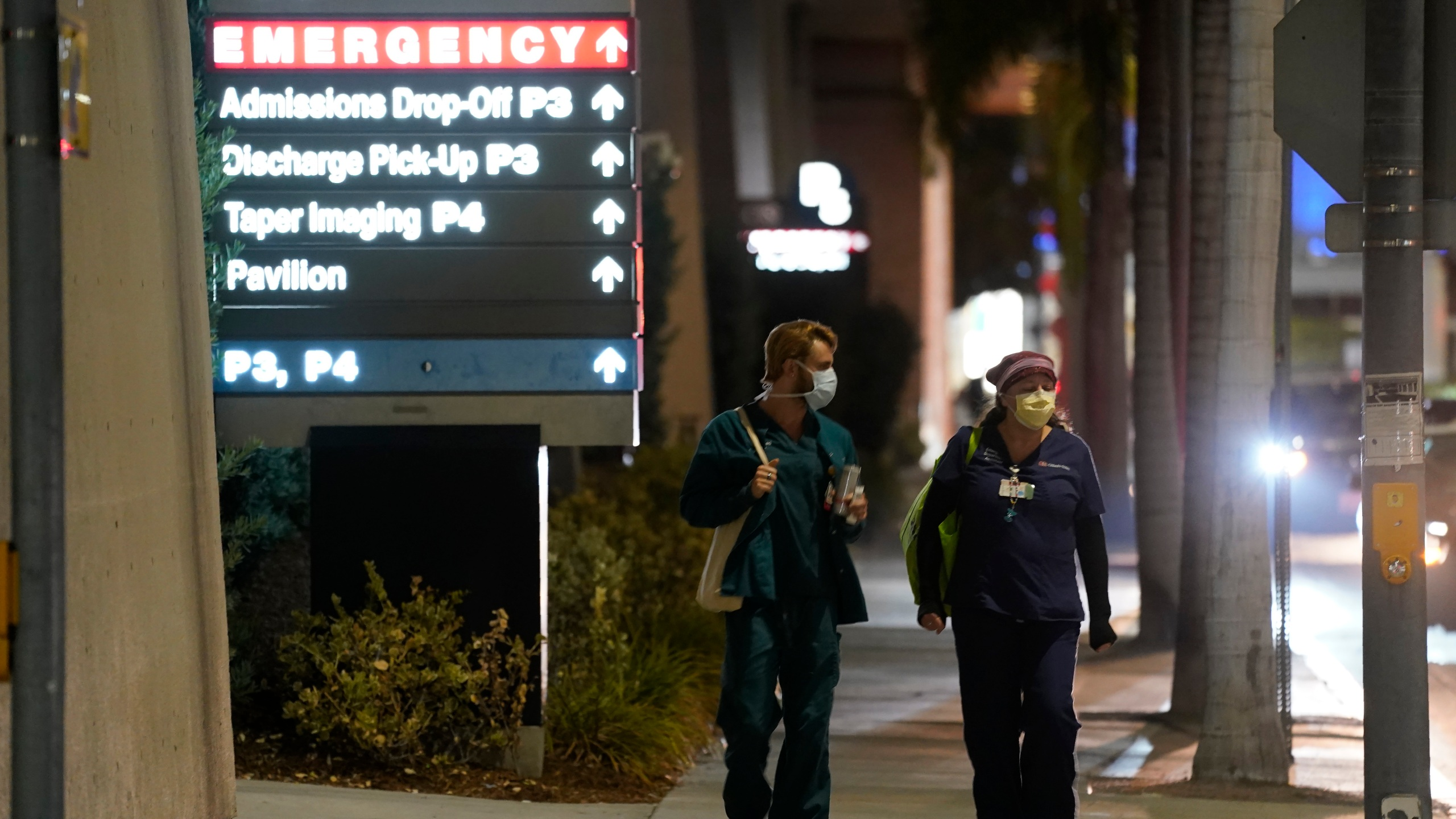 In this Jan. 5, 2021, file photo, Cedars-Sinai Medical Center workers walk outside the hospital, in Los Angeles. The California Senate has rejected a bill aimed at making it easier for some hospital workers to get workers compensation benefits. (AP Photo/Chris Pizzello,File)