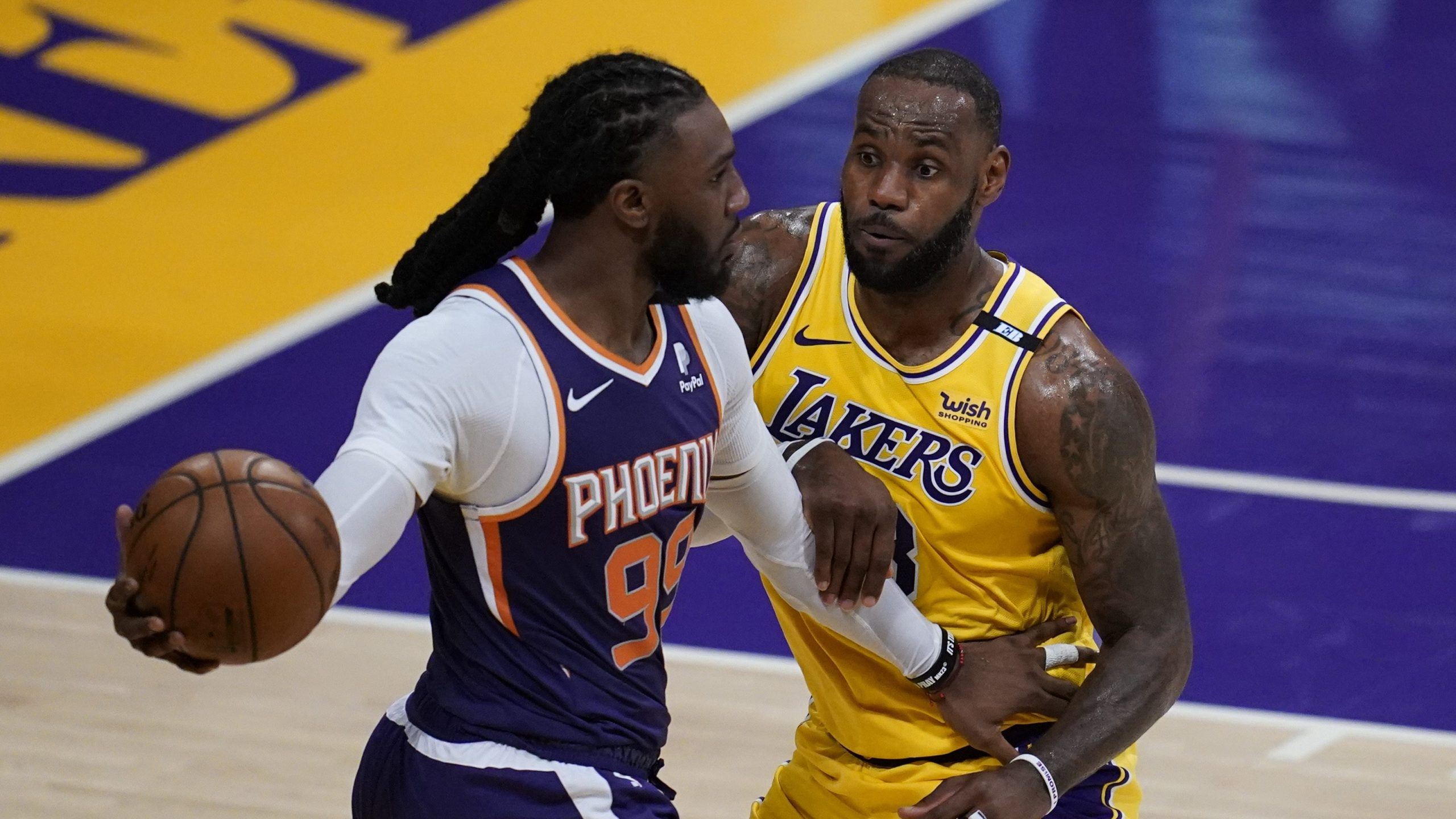 Los Angeles Lakers forward LeBron James (23) defends against Phoenix Suns forward Jae Crowder (99) during the second quarter of Game 6 of an NBA basketball first-round playoff series in Los Angeles on June 3, 2021. (Ashley Landis / Associated Press)