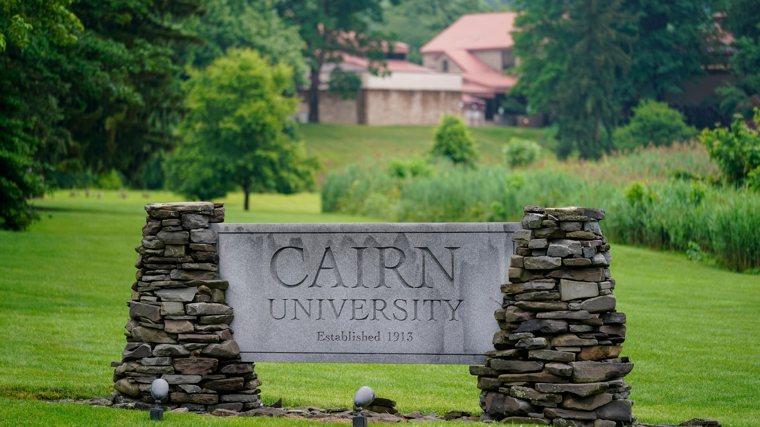 A sign for Cairn University is displayed at the campus in Langhorne, Pa., Friday, June 4, 2021. The Christian university outside of Philadelphia has shuttered its highly-regarded social work degree program partly because university officials said the national accrediting agency was attempting to impose values regarding sexuality and gender that did not align with the university's religious mission. (AP Photo/Matt Rourke)
