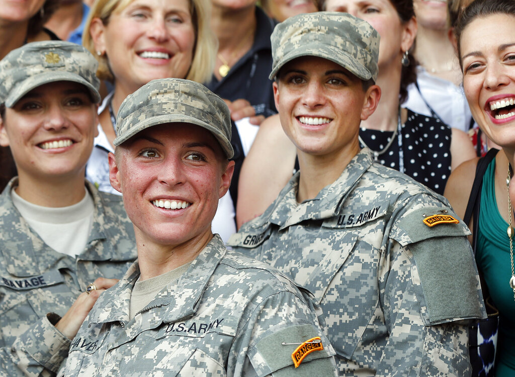 In this Aug. 21, 2015, file photo, Army 1st Lt. Shaye Haver, center, and Capt. Kristen Griest, right, pose for photos with other female West Point alumni after an Army Ranger school graduation ceremony at Fort Benning, Ga. Haver and Griest became the first female graduates of the Army's rigorous Ranger School. (AP Photo/John Bazemore, File)