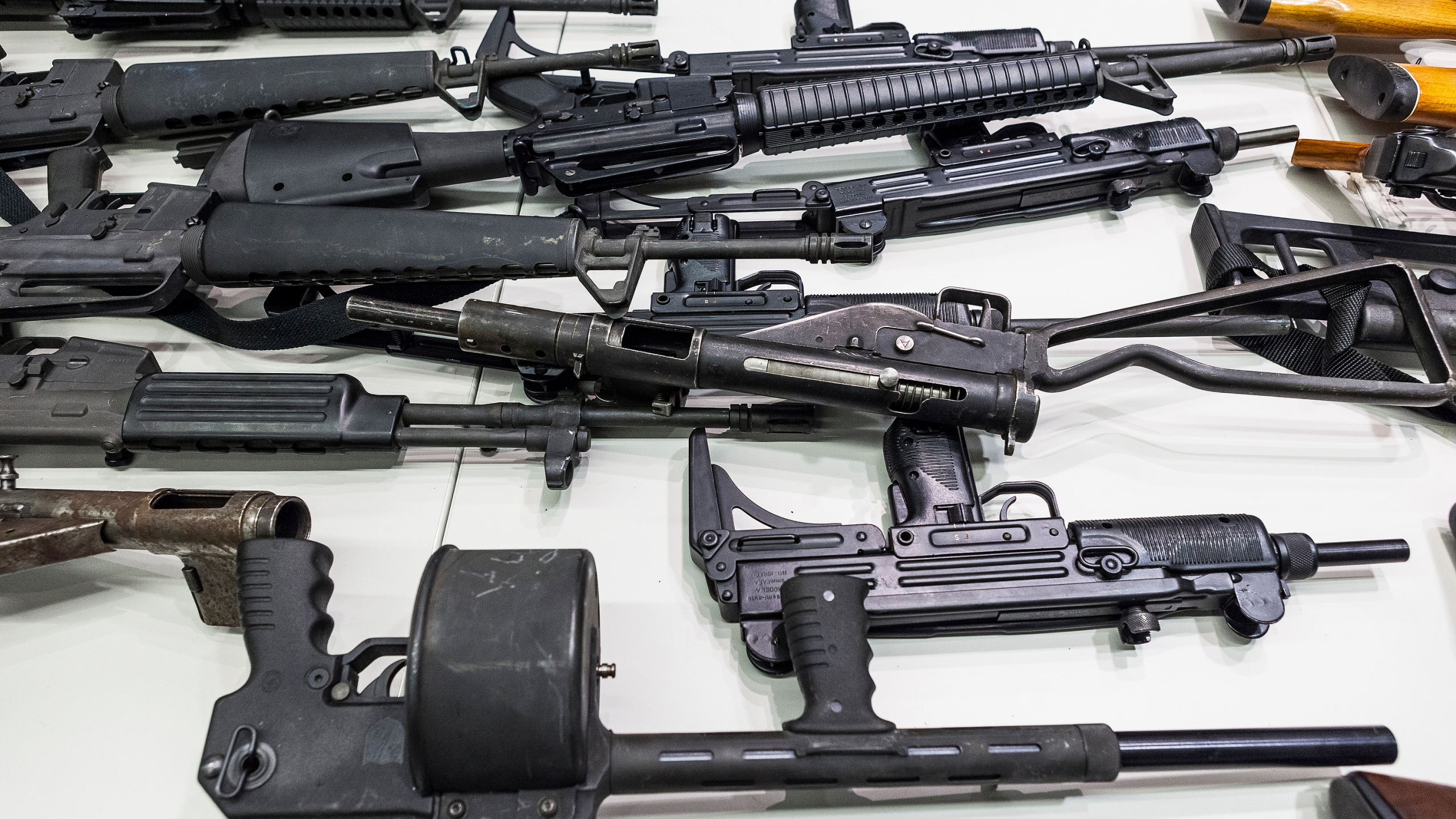In this Dec. 27, 2012, file photo are some of the weapons that include handguns, rifles, shotguns and assault weapons, collected in a Los Angeles Gun Buyback event displayed during a news conference at the LAPD headquarters in Los Angeles. A federal judge has overturned California's three-decade-old ban on assault weapons, ruling that it violates the constitutional right to bear arms. U.S. District Judge Roger Benitez of San Diego ruled Friday, June 4, 2021, that the state's definition of illegal military-style rifles unlawfully deprives law-abiding Californians of weapons commonly allowed in most other states. (AP Photo/Damian Dovarganes, File)