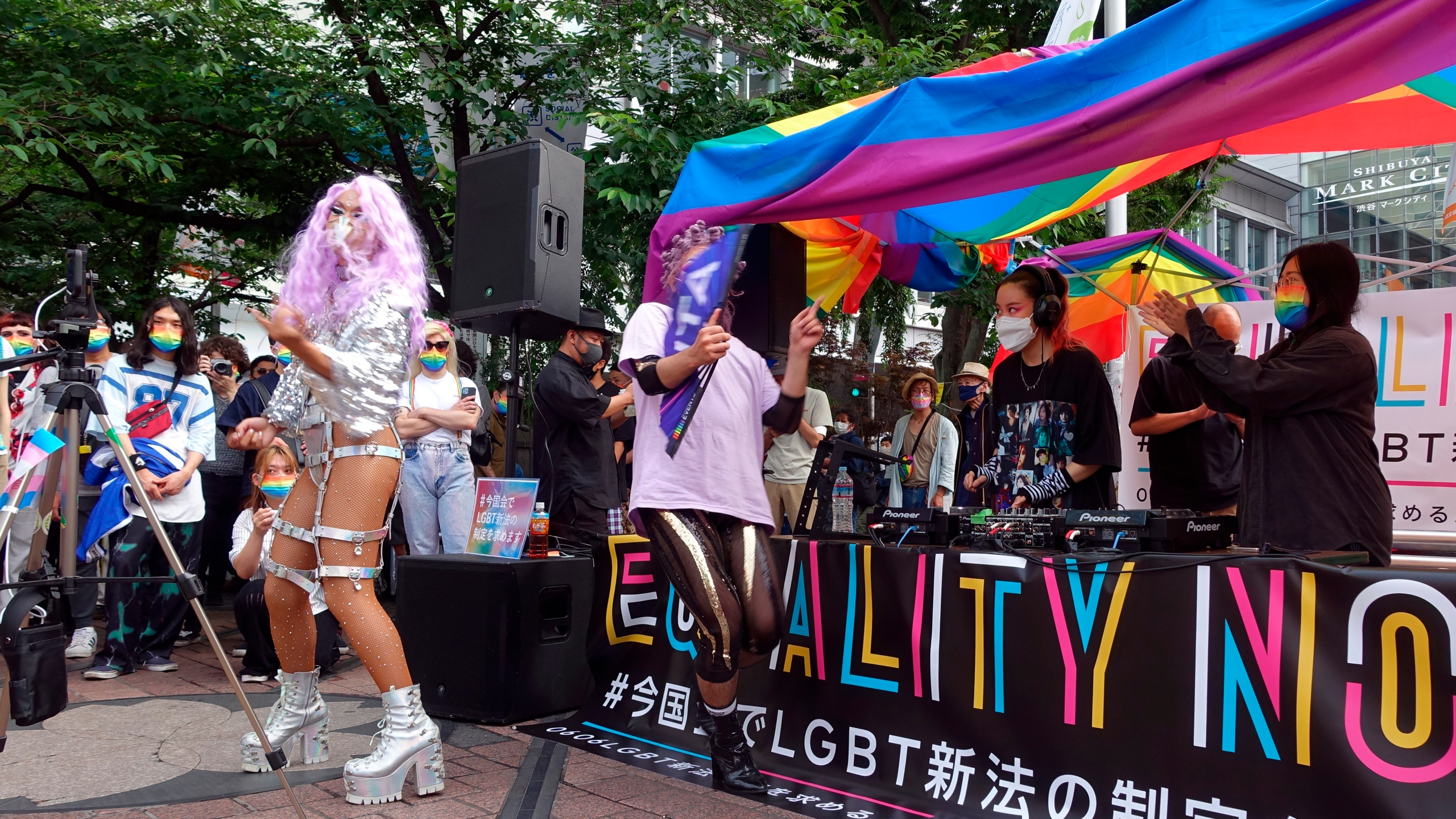 Dozens of LGBTQ activists and supporters of equal rights laws gather at the Shibuya district Sunday June 6, 2021, in Tokyo. (AP Photo/Mari Yamaguchi)