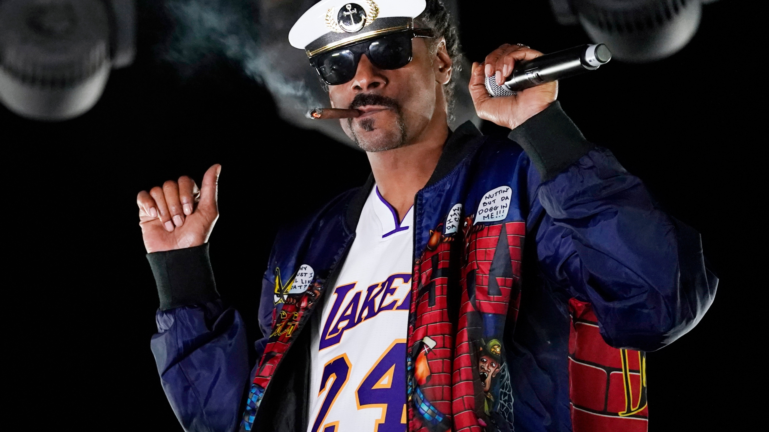 """Snoop Dogg performs a DJ set as """"DJ Snoopadelic"""" during the """"Concerts In Your Car"""" series on Oct. 2, 2020, in Ventura. (Chris Pizzello/Associated Press)"""