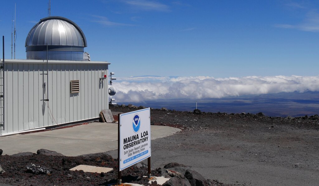 This 2019 photo provided by NOAA shows the Mauna Loa Atmospheric Baseline Observatory, high atop Hawaii's largest mountain in order to sample well-mixed background air free of local pollution. (Susan Cobb/NOAA Global Monitoring Laboratory via AP)