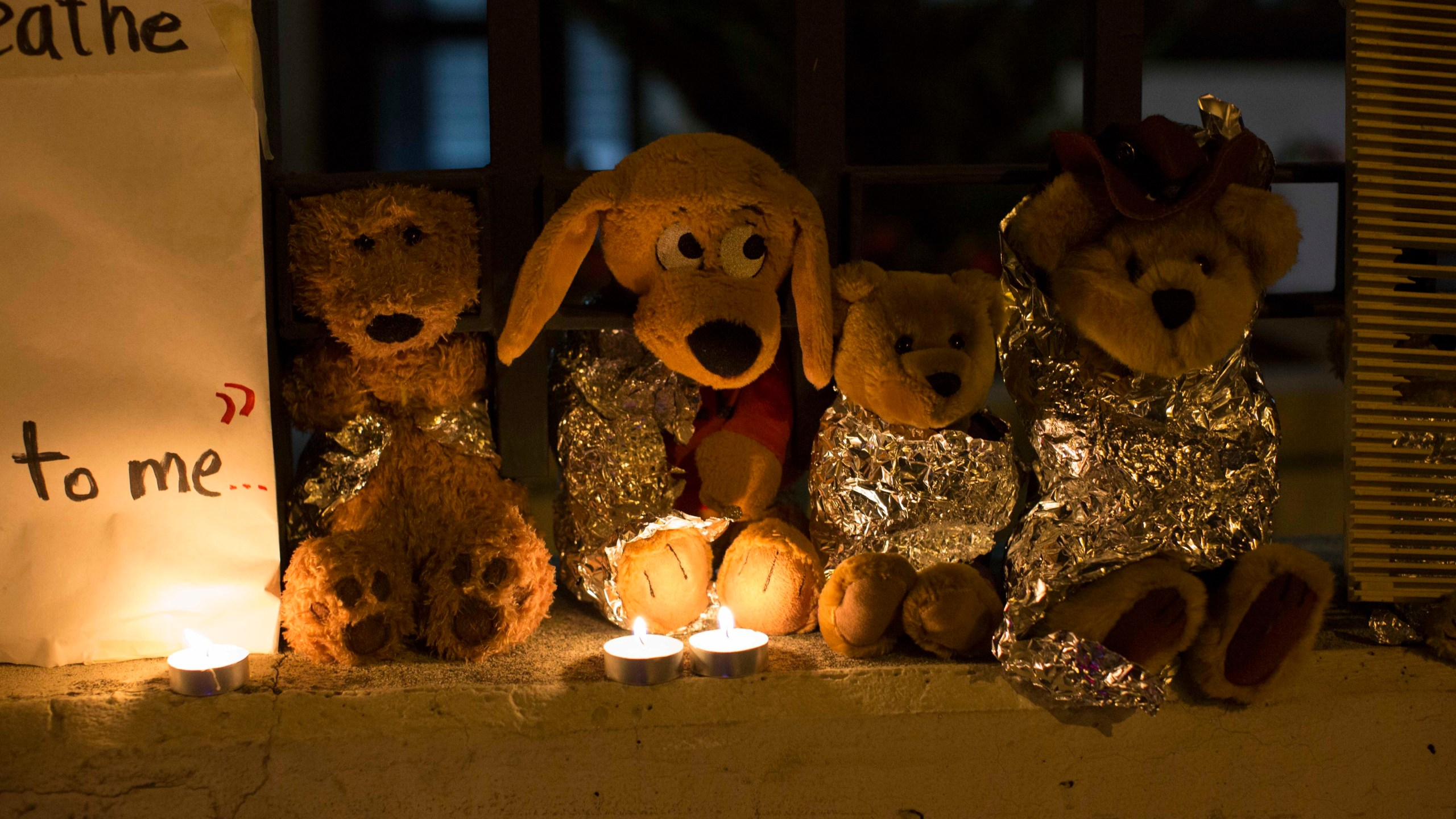 In this Wednesday, June 20, 2018, file photo, stuffed toy animals wrapped in aluminum foil representing migrant children separated from their families are displayed in protest in front of the United States embassy in Guatemala City. In a report released Tuesday, June 8, 2021, the Biden administration says it has identified more than 3,900 children separated at the border under former President Donald Trump's 'zero-tolerance' policy on illegal crossings. (AP Photo/Luis Soto, File)