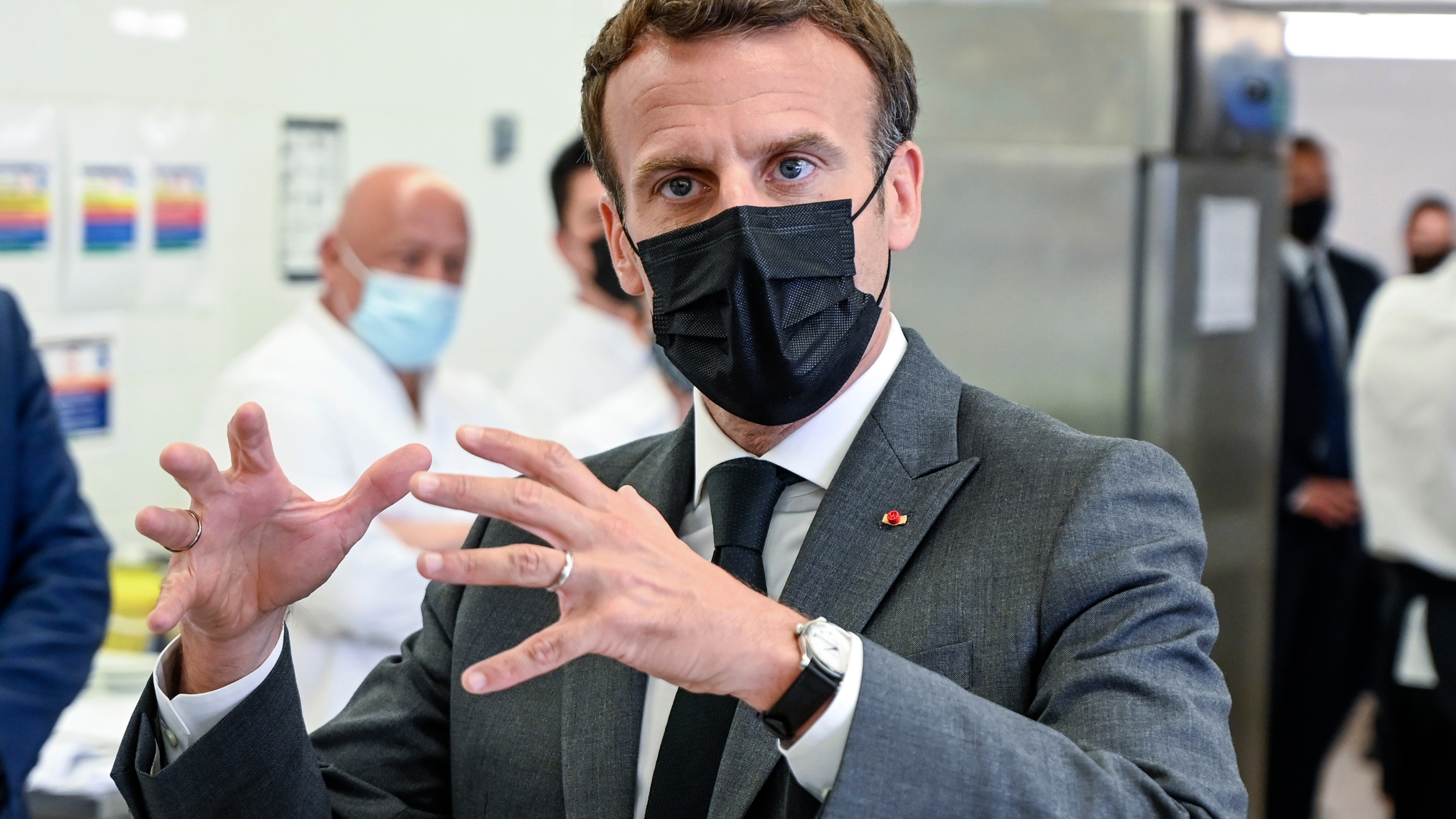 French President Emmanuel Macron talks to journalists Tuesday June 8, 2021 at the Hospitality school in Tain-l'Hermitage, southeastern France. French President Emmanuel Macron has been slapped in the face by a man during a visit in a small town of southeastern France, Macron's office confirmed. (Philippe Desmazes, Pool via AP)